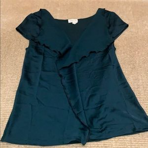 Emerald green capsleeved blouse from Anthropologie